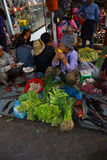 Woman selling vegetables Royalty Free Stock Image
