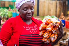 Woman selling vegetables Royalty Free Stock Photos