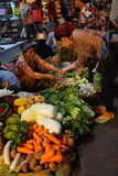 Woman selling vegetables Stock Image