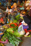 Woman selling vegetables Stock Images