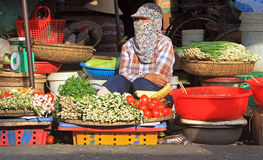 Woman is selling vegetables on street market in Hue Stock Image