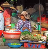 Woman is selling vegetables on street market in Hue, Vietnam Royalty Free Stock Images