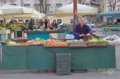Woman is selling vegetables on the street market in Ljubljana, Slovenia Stock Photos