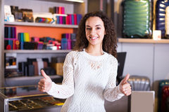 Woman selling wallets and bags Stock Photo