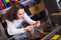 Woman selling wallets at shop Royalty Free Stock Image