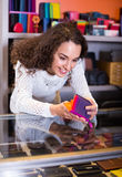 Woman selling wallets at shop Stock Images
