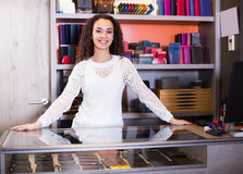 Woman selling wallets at shop Stock Photography