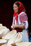 Woman selling wood plates at a traditional fair. Picture taken in Bucharest, 13 september 2009 at a traditional fair, showing a countrywoman selling handcrafted stock photography