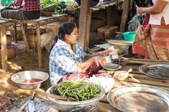 Woman selling yard long beans at asian market. Bagan, Myanmar Royalty Free Stock Image
