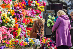 Woman sells artificial flowers for Radunitsa Stock Image