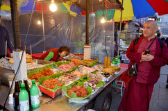 Woman sells foods a the Namdaemun market Royalty Free Stock Image