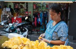 Woman sells fruit on the street in Thailand Stock Photos