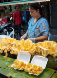 Woman sells fruit on the street in Thailand Stock Images
