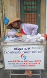 Woman sells lottery tickets on streetin Hanoi Stock Photos