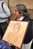 Woman sells Portet Michael Jackson. Royalty Free Stock Photography
