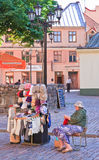 A woman sells souvenirs. Riga, Latvia Stock Images