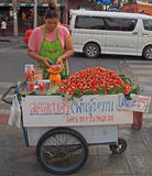 Woman sells strawberries outdoor in Bangkok, Thailand Royalty Free Stock Image