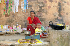 Woman sells on the street in India Royalty Free Stock Photos