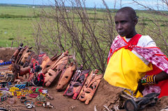 Woman sells traditional souvenirs at Maasai Mara, Kenya. Stock Images