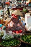 Woman sells vegs at the morning market, Nha Trang, Vietnam. Royalty Free Stock Photos