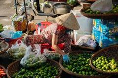 Woman sells vegs at the morning market, Nha Trang, Vietnam. Stock Photography