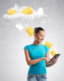 Woman sending data to a cloud Royalty Free Stock Images