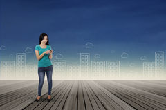 Woman sending information with smartphone 1 Stock Images