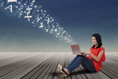 Woman sending information to cloud storage Royalty Free Stock Images