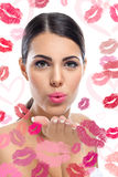 Woman sending kiss Stock Images