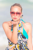 Woman sending a kiss from summer vacations. Royalty Free Stock Photo