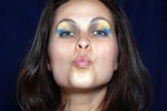 Woman is sending a kiss Royalty Free Stock Image