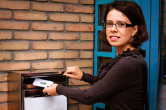 Woman sending a letter Stock Images