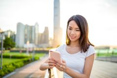 Woman sending message on cellphone Stock Photography