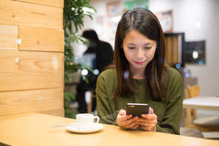 Woman sending message on mobile phone Stock Images
