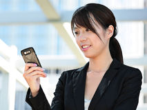 Woman sending message on phone Stock Images