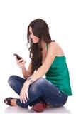 Woman sending an sms Stock Image