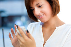 Woman sending sms Stock Photography