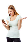 Woman sending a sms on cell phone, isolated on white. Royalty Free Stock Photography