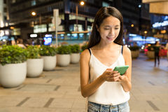 Woman sending sms on cellphone. Asian young woman Royalty Free Stock Photos