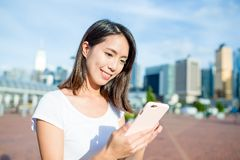 Woman sending sms on mobile phone Stock Images