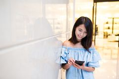 Woman sending sms on mobile phone Stock Photos