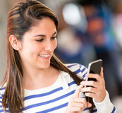 Woman sending a text Stock Images