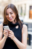 Woman sending a text message Royalty Free Stock Photography