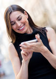 Woman sending a text message Royalty Free Stock Images