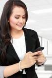 Woman sending text message Stock Photography