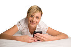 Woman sending a text message. Beautul woman using her phone for texting Royalty Free Stock Images