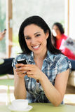 Woman Sending Text Message In Cafe Royalty Free Stock Photos