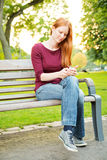 A Woman Sending a Text Message Royalty Free Stock Photography