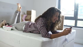 Woman Sending Text Message Having Moved Into New Home stock video