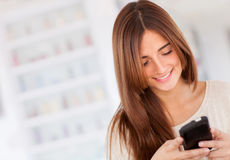 Woman sending text message Royalty Free Stock Photos
